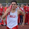 Francisco Valdovinos, who won the open 800, runs on the 4 x 400 relay. Holly's boys had an easy victory but Ortonville Brandon's girls were chased to the wire in a Flint Metro League track and field meet Tuesday between the only Oakland County teams in the conference. (MIPrepZone photo gallery by MARVIN GOODWIN).
