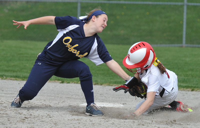 Oxford shortstop Sarah Tyrrell tags out Swartz Creek's Lily Majestic at 2nd base during the tournament held on Saturday April 15, 2017 at Lake Orion High School.  Lake Orion defeated Oxford 1-0 to win the title.  (MIPrepZone photo by Ken Swart)