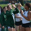 Lake Orion's Taylor Eaton (right), who won the shot put and discus throws, high-fives teammates. Lake Orion's girls scored at will while the boys survived some lineup absences as the Dragons defeated Rochester Adams in an OAA Red dual track and field meet Wednesday at Adams. (MIPrepZone photo gallery by MARVIN GOODWIN).