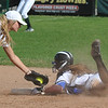 Lakeland's Elizabeth Langley eludes the tag from Waterford Kettering's Taylor Reno during the DH played on Wednesday May 3, 2017 at Kettering HS.  The Eagles swept the DH 9-0<br />  and 11-2.  (MIPrepZone photo by Ken Swart)