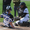 Waterford Kettering catcher Brennah Watson tags out Lakeland's Kaley Miller (15) at the plate during the DH played on Wednesday May 3, 2017 at Kettering HS.  The Captains lost both games to the Eagles 9-0 and 11-2. (MIPrepZone photo by Ken Swart)