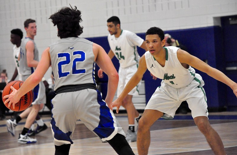 Novi and Lakeland faced off in a Class A boys basketball regional semifinal game at Salem High School on Monday, March 12, 2018. (Photos by Dan Fenner/The Oakland Press)