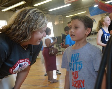 Dr. Ann Marsh-Senic chats with 7-year-old Suren Antonucci at the Renaissance Fencing Club in Troy. (Marvin Goodwin photo).
