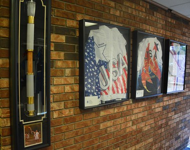 The Olympic torch and the three Olympic jackets worn by Dr. Ann Marsh-Senic are displayed at the Renaissance Fencing Club in Troy. (Marvin Goodwin photo).