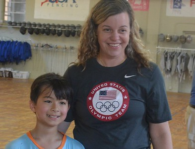 Dr. Ann-Marsh Senic poses after a training session with youngsters at the Renaissance Fencing Club in Troy. (Marvin Goodwin photo).