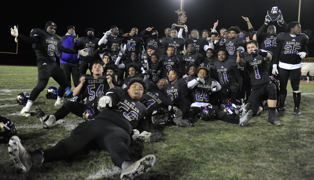 . The Madison Heights Madison Eagles Show off the MHSAA D7 Regional Trophy after defeating Monroe St. Mary Catholic Central 22-20.  The game was played on Friday Nov. 10, 2017 at MH Madison HS.  (Oakland Press photo by Ken Swart)