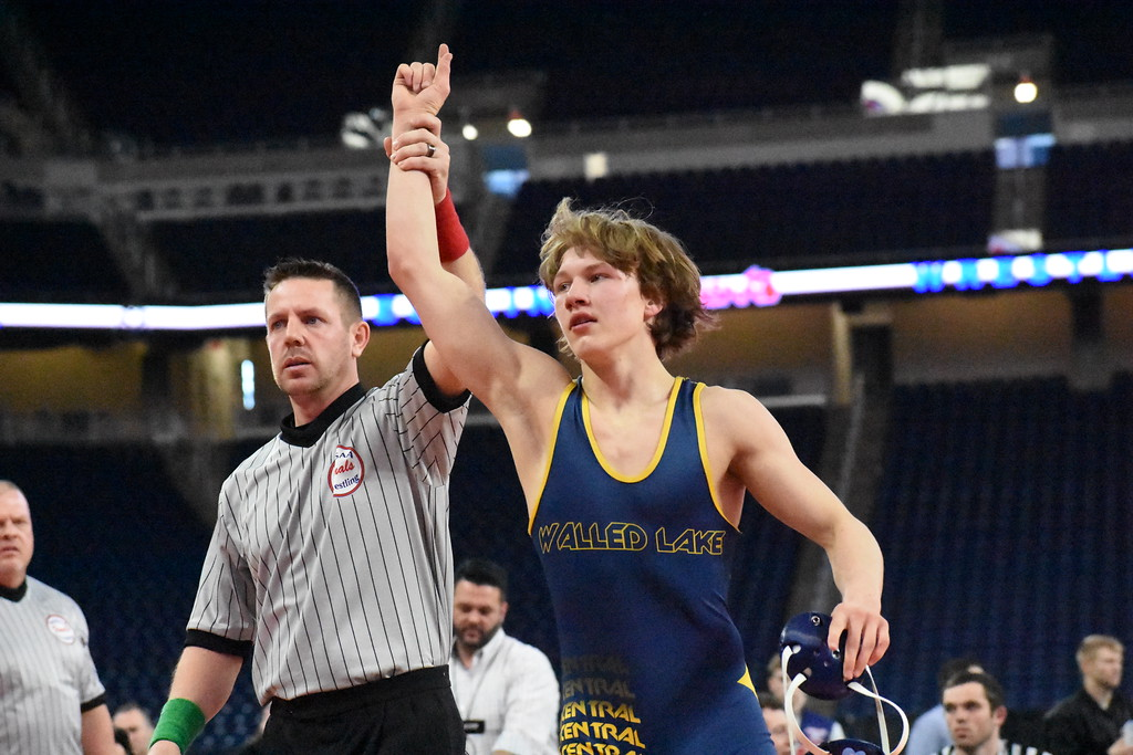 . Walled Lake Central senior Nick Freeman has his hand raised after capturing the 140-pound state championship in Division 1 Saturday at Ford Field in Detroit. (Digital First Media photo by Jason Schmitt)