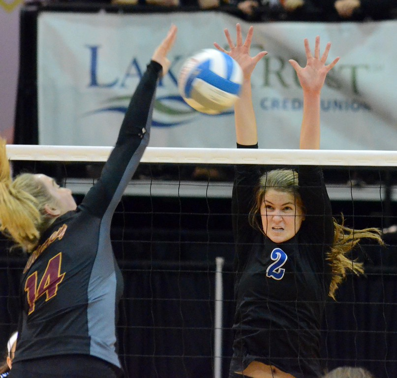 . Birmingham Marian earned a four-set win over Farmington Hills Mercy in the Class A volleyball semifinal on Thursday at the Kellogg Arena in Battle Creek. The Mustangs won by scores of 13-25, 25-20, 25-20, 25-21 (Oakland Press photo gallery by Drew Ellis)