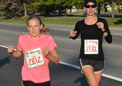 Runners of all ages, shapes and sizes took advantage of ideal weather conditions Sunday at the ninth annual HealthPlus Brooksie Way Half-Marathon, 5K and 10K races through the streets and neighborhoods of Rochester Hills. (Photo gallery by MARVIN GOODWIN).