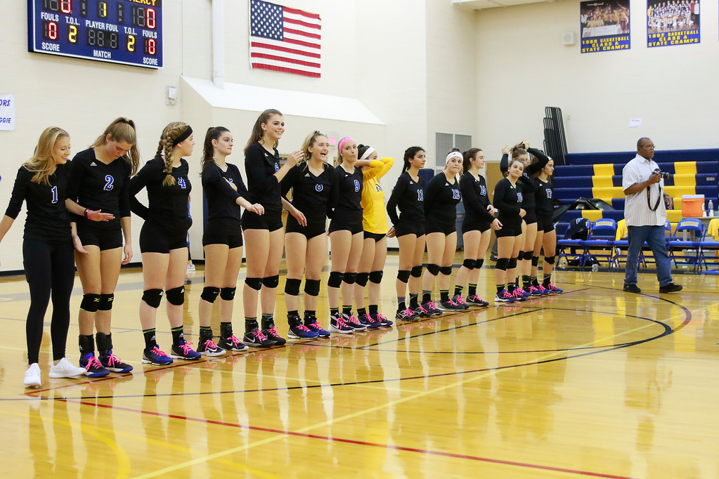 . It took five sets but visiting Farmington Hills Mercy took home the victory Wednesday night at Marian and now sits atop of the CHSL Central Division alone at 4-0 in league play. (Oakland Press photo by Timothy Arrick)