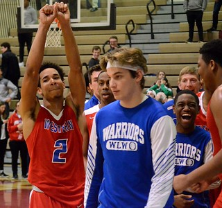 The Walled Lake Western boys basketball team held off Milford for a 50-48 victory at Milford High School in the Class A district semifinal. (Oakland Press photo gallery By Drew Ellis)