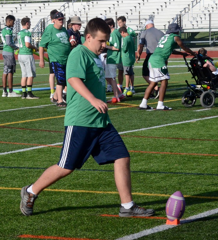 . Novi High School, in conjunction with Easterseals of Michigan, played host to its third annual Football Camp For Kids With Disabilities on Monday night. Members of the Novi football and cheer teams were joined by members of the South Lyon East football team as they took the participants through drills that simulated a typical football practice. (Oakland Press photo gallery by Drew Ellis)