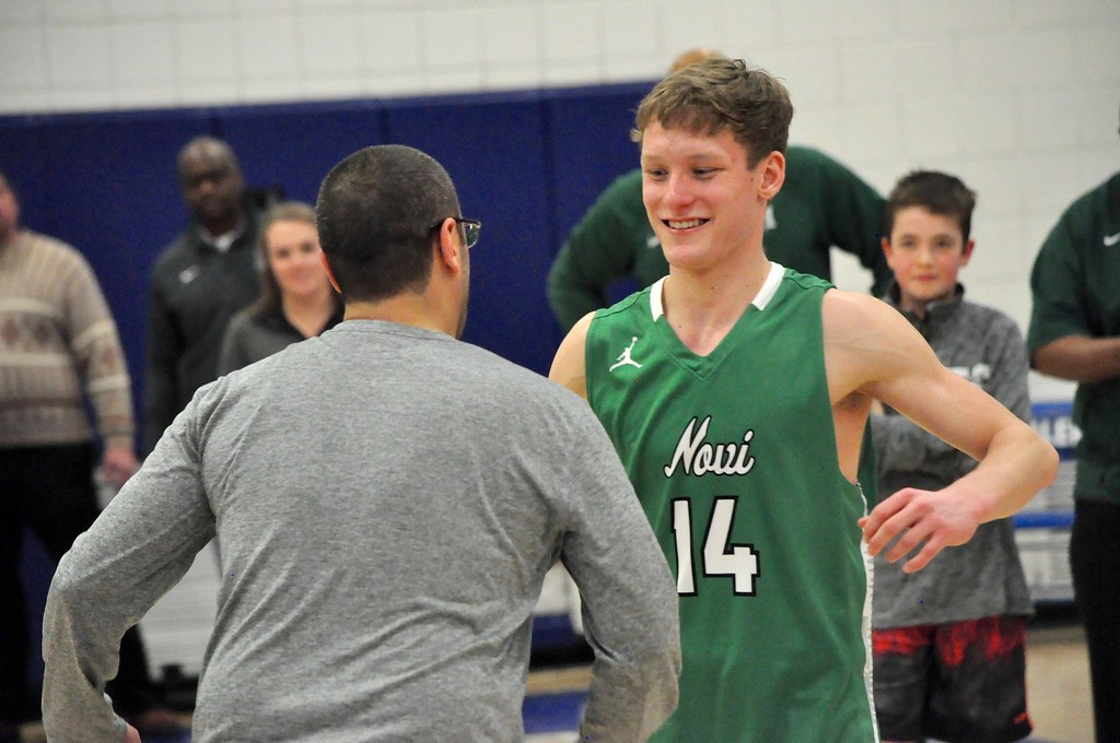. Novi defeated Ann Arbor Skyline, 61-59, in a Class A regional final at Salem High School on Wednesday, March 14, 2018. (Photo gallery by Dan Fenner/The Oakland Press)