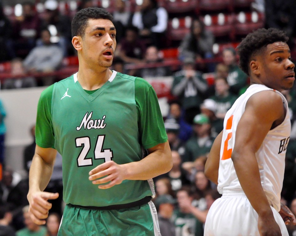 . Novi and Belleville squared off in a Class A boys basketball quarterfinals game at the University of Detroit Mercy on Tuesday, March 20, 2018. (Photo gallery by Dan Fenner/The Oakland Press)