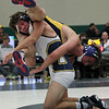 Trent Myer, Oxford, attempts to flip opponent Houston Hemingsen, Clarkston, in their 152-pound match during the 57th annual Oakland County wrestling championship at Lake Orion High School Saturday, Dec. 17, 2016. Myer eventually won his match to help the  Wildcats take home the team trophy with a total of 268.5 points. Clarkston finished in second place with 238. (MIPrepZone photo / LARRY McKEE)
