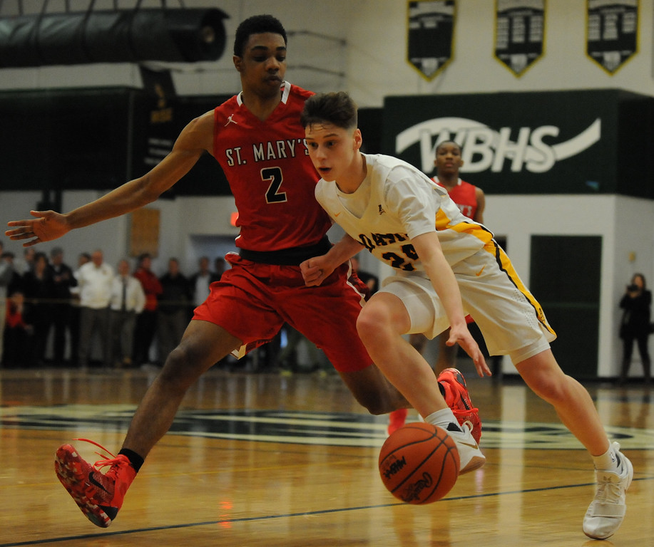 . Rochester Adams\' Ethan Emerzian (R) tries to move past OLSM\'s Geordon Duncan (2) during the Class A Regional Semi-final played on Monday March 12, 2018 at West Bloomfield High School.   The Highlanders lost to the Eaglets 41-35.  (Oakland Press photo by Ken Swart)
