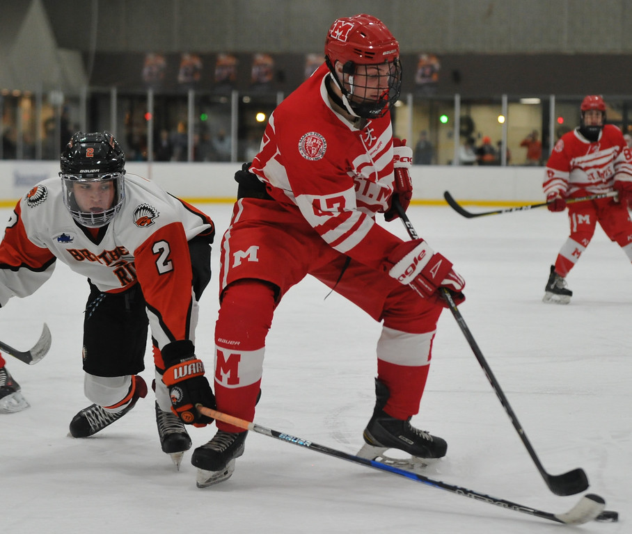 . Birmingham Brother Rice\'s Ethan Nystrom (2) tries to steal the puck from Orchard Lake St. Mary\'s Preston Hazelton (43) during the game played on Wednesday December 6, 2017 at the Oak Park Ice Arena.  OLSM defeated the Warriors 5-2. (Oakland Press photo by Ken Swart)