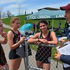Birmingham Seaholm's trio of Audrey Ladd (from left), Emily Rooney and Rachel McCardell were big scorers for the Maples in distance events. Oak Park's boys and girls were winners at the 55th annual Elmer Ball Oxford Invitational Saturday at Oxford High. Lake Orion's girls were second and Walled Lake Central's boys finished second in a meet of standout performances. (MIPrepZone photo gallery by MARVIN GOODWIN).