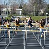 Lukas Adgate of Rochester Adams and Donovan Tolbert of Clarkston man the two middle lanes in the high hurdles. (MIPrepZone file photo).