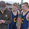 Clarkston's Grant Telfer (right) and Max Salter check their times from Adams coach Eric Lohr. (MIPrepZone file photo).
