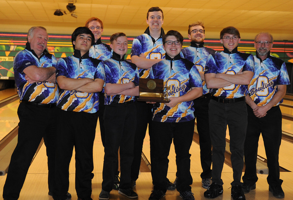 . The Oxford Wildcats show off the hardware after winning the Oakland County Bowling Tournament held on Sunday January 14, 2018 at Cherry Hill Lanes in Clarkston.  Farmington Harrison finished second, while North Farmington was third.  (Oakland Press photo by Ken Swart)