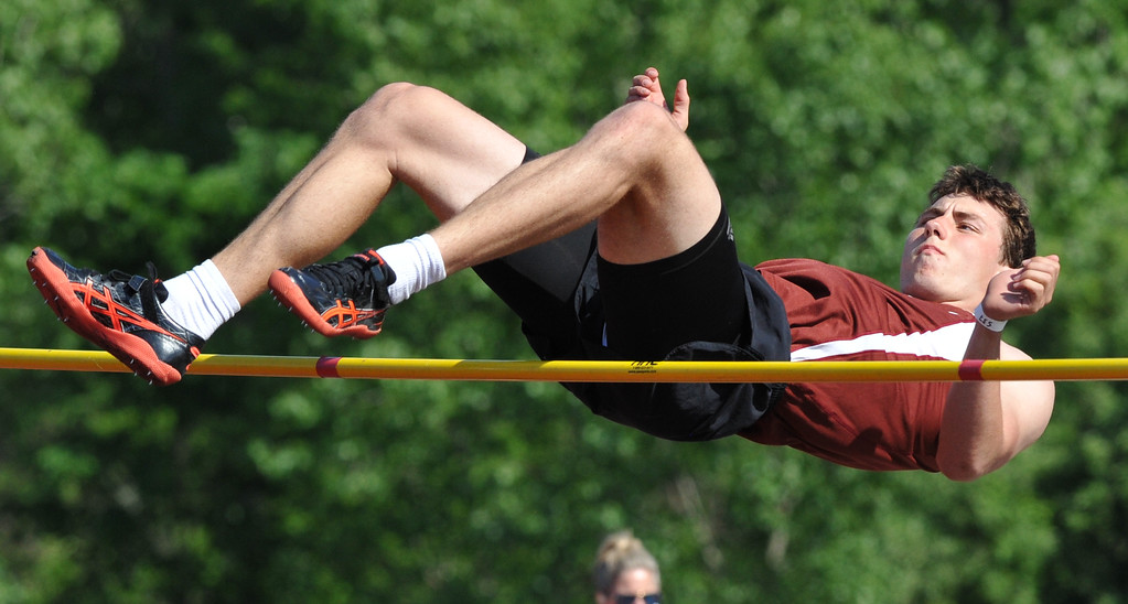 """. Birmingham Seaholm\'s Ben Barton wins the high jump event clearing 6\'6\"""" during the 59th annual Oakland Country Track meet held on Friday May 25, 2018 at Novi High School.  Oak Park won both the girls and boys titles. (Oakland Press photo by Ken Swart)"""