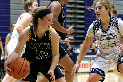 For a while it looked like neither Oxford or Farmington would get on the board but once the scoring started, Oxford poured it on taking a 25-15 halftime lead and cruising to a 46-29 victory over the Falcons Friday January 4, 2019 in Farmington. (Oakland Press photo by Timothy Arrick)