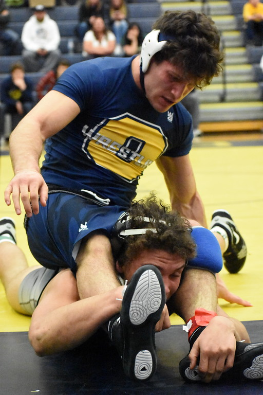 . Oxford\'s Devin Trevino (top) and Lake Orion\'s Tyler Vestrand fight for control in their 171-pound match during the Division 1 regional final Wednesday night at Clarkston High School. Vestrand pulled out an 11-6 victory, but Oxford won the match, 51-20. (For Digital First Media - Jason Schmitt)