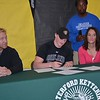 Waterford Kettering senior Kyle Piotrovsky, with assistant coach Tyron Logan and parents Howard and Heather, signed a National Letter-of-Intent Wednesday to join Oakland University's track and field team as a scholarship athlete. (MIPrepZone photo gallery by MARVIN GOODWIN).
