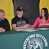 Waterford Kettering senior Kyle Piotrovsky, who signed a National Letter-of-Intent Wednesday to join Oakland University's track and field team as a scholarship athlete, is joined by dad Howard and mom Heather. (MIPrepZone photo gallery by MARVIN GOODWIN).