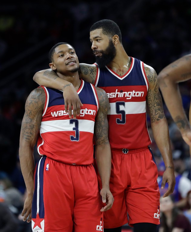 . Washington Wizards forward Markieff Morris (5) and guard Bradley Beal (3) walk onto the court during the second half of an NBA basketball game against the Detroit Pistons, Saturday, Jan. 21, 2017, in Auburn Hills, Mich. (AP Photo/Carlos Osorio)