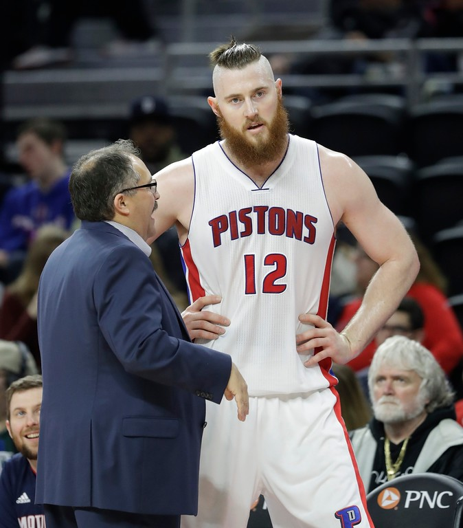 . Detroit Pistons head coach Stan Van Gundy talks with center Aron Baynes during the second half of an NBA basketball game against the Washington Wizards, Saturday, Jan. 21, 2017, in Auburn Hills, Mich. (AP Photo/Carlos Osorio)