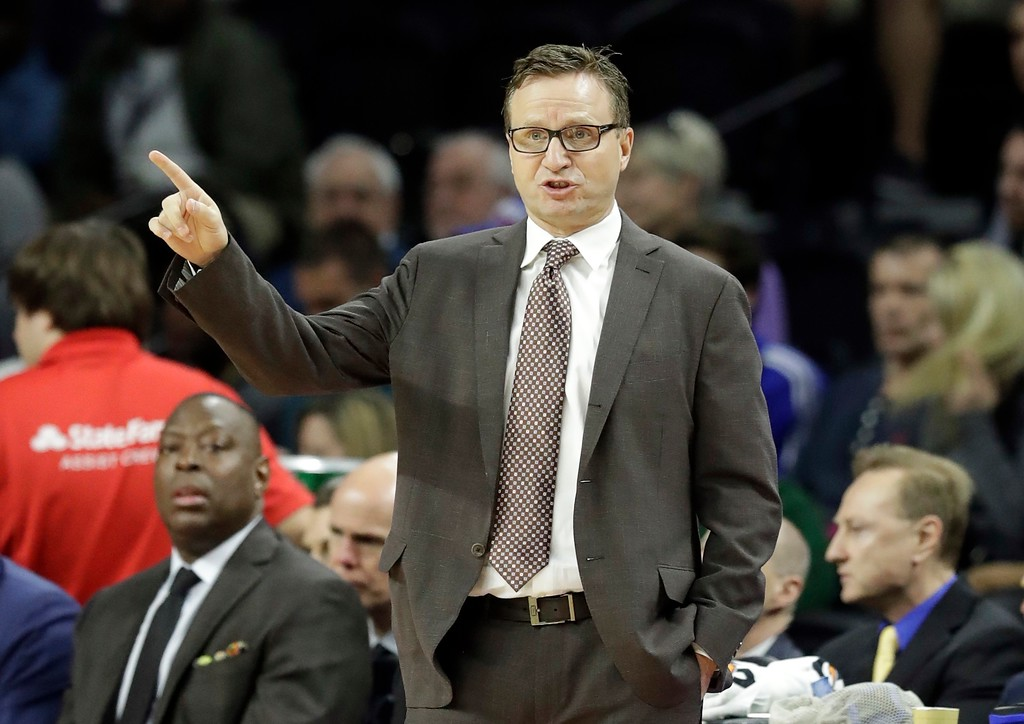 . Washington Wizards head coach Scott Brooks gestures from the sidelines during the first half of an NBA basketball game against the Detroit Pistons, Saturday, Jan. 21, 2017, in Auburn Hills, Mich. (AP Photo/Carlos Osorio)