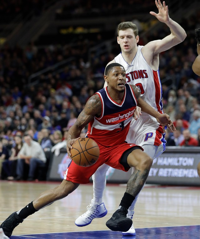 . Washington Wizards guard Bradley Beal (3) drives to the basket around Detroit Pistons forward Jon Leuer during the second half of an NBA basketball game, Saturday, Jan. 21, 2017, in Auburn Hills, Mich. (AP Photo/Carlos Osorio)