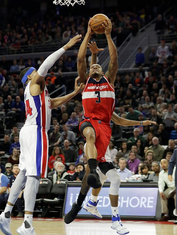 . Washington Wizards guard Bradley Beal (3) shoots during the second half of an NBA basketball game against the Detroit Pistons, Saturday, Jan. 21, 2017, in Auburn Hills, Mich. (AP Photo/Carlos Osorio)