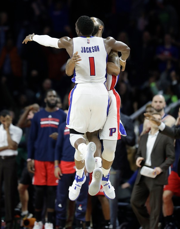 . Detroit Pistons forward Marcus Morris and teammate guard Reggie Jackson (1) celebrate Morris\' game winning tip in during the second half of an NBA basketball game against the Washington Wizards, Saturday, Jan. 21, 2017, in Auburn Hills, Mich. Detroit defeated Washington 113-112. (AP Photo/Carlos Osorio)