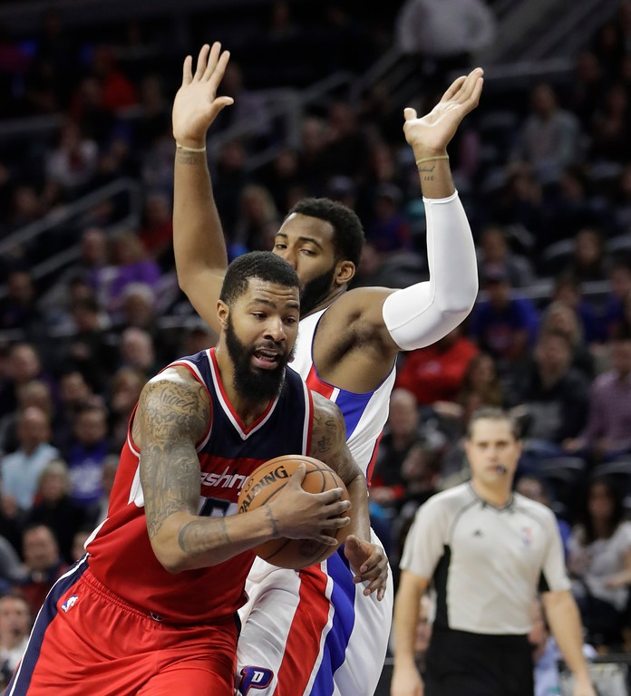 . Washington Wizards forward Markieff Morris drives on Detroit Pistons center Andre Drummond during the second half of an NBA basketball game, Saturday, Jan. 21, 2017, in Auburn Hills, Mich. (AP Photo/Carlos Osorio)