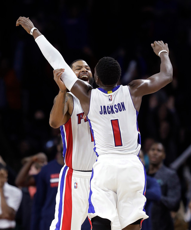 . Detroit Pistons forward Marcus Morris and guard Reggie Jackson (1) celebrate Morris\' game-winning tip-in during the second half of the team\'s NBA basketball game against the Washington Wizards, Saturday, Jan. 21, 2017, in Auburn Hills, Mich. Detroit defeated Washington 113-112. (AP Photo/Carlos Osorio)