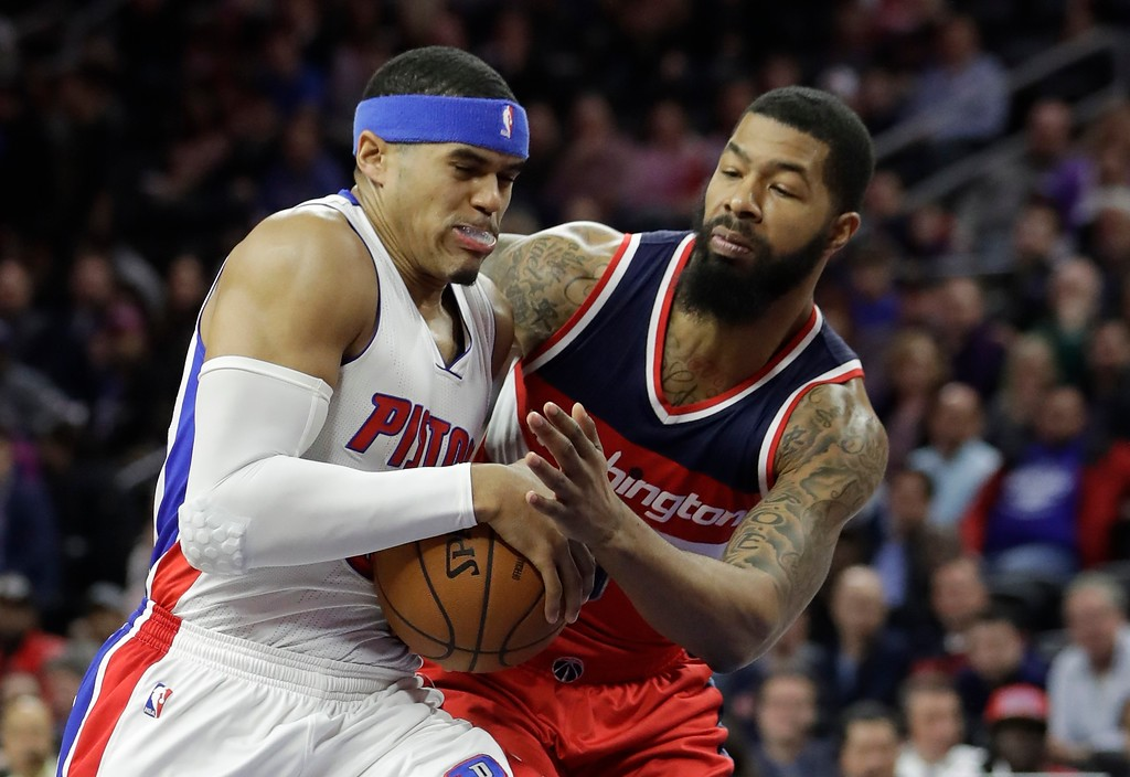 . Washington Wizards forward Markieff Morris reaches in on Detroit Pistons forward Tobias Harris during the first half of an NBA basketball game, Saturday, Jan. 21, 2017, in Auburn Hills, Mich. (AP Photo/Carlos Osorio)