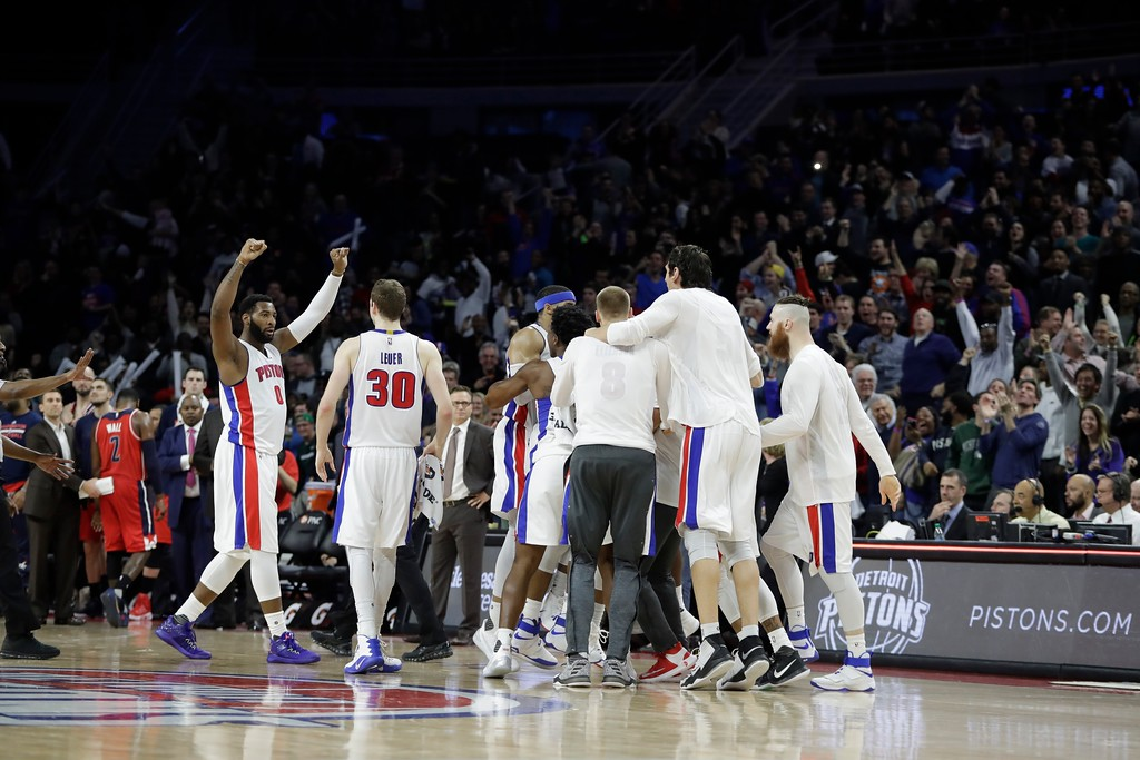 . The Detroit Pistons celebrate their 113-112 win over the Washington Wizards after an NBA basketball game, Saturday, Jan. 21, 2017, in Auburn Hills, Mich. (AP Photo/Carlos Osorio)