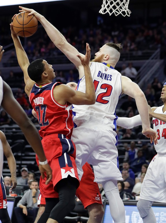 . Detroit Pistons center Aron Baynes (12) blocks a shot by Washington Wizards forward Otto Porter Jr. (22) during the second half of an NBA basketball game, Saturday, Jan. 21, 2017, in Auburn Hills, Mich. (AP Photo/Carlos Osorio)