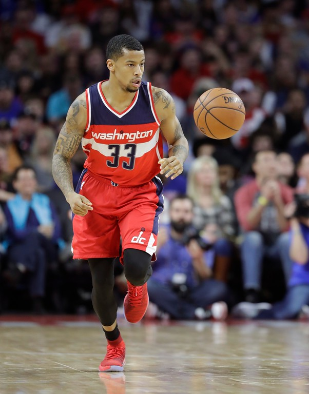 . Washington Wizards guard Trey Burke brings the ball up court during the second half of an NBA basketball game against the Detroit Pistons, Saturday, Jan. 21, 2017, in Auburn Hills, Mich. (AP Photo/Carlos Osorio)
