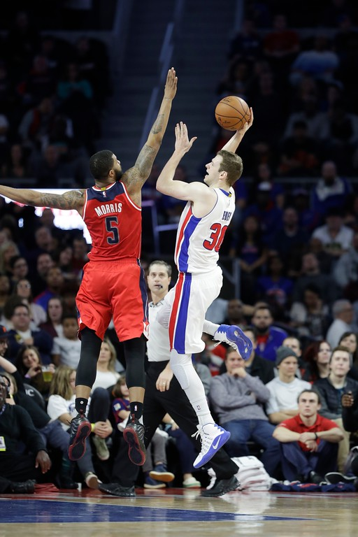 . Detroit Pistons forward Jon Leuer (30) shoots over Washington Wizards forward Markieff Morris (5) during the second half of an NBA basketball game, Saturday, Jan. 21, 2017, in Auburn Hills, Mich. (AP Photo/Carlos Osorio)