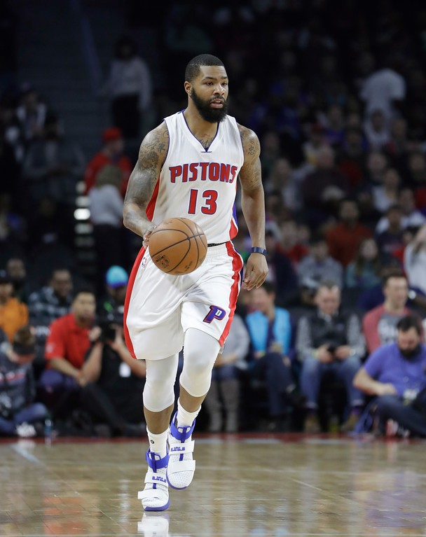 . Detroit Pistons forward Marcus Morris brings the ball up court during the first half of an NBA basketball game against the Washington Wizards, Saturday, Jan. 21, 2017, in Auburn Hills, Mich. (AP Photo/Carlos Osorio)