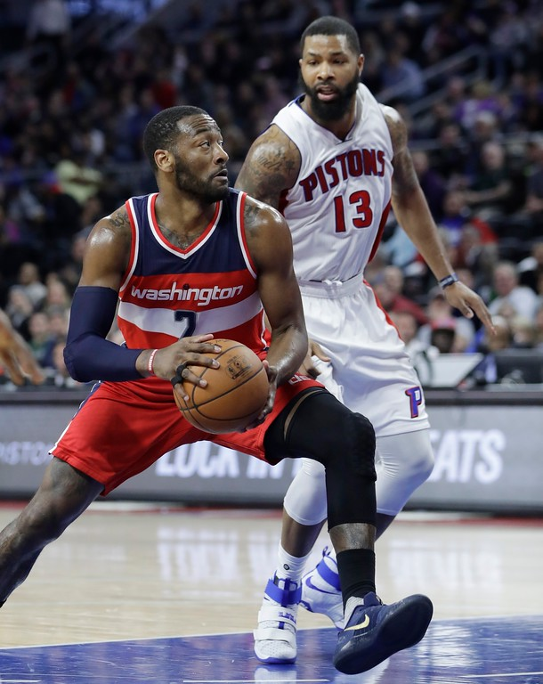 . Washington Wizards guard John Wall (2) drives to the basket during the second half of an NBA basketball game against the Detroit Pistons, Saturday, Jan. 21, 2017, in Auburn Hills, Mich. (AP Photo/Carlos Osorio)