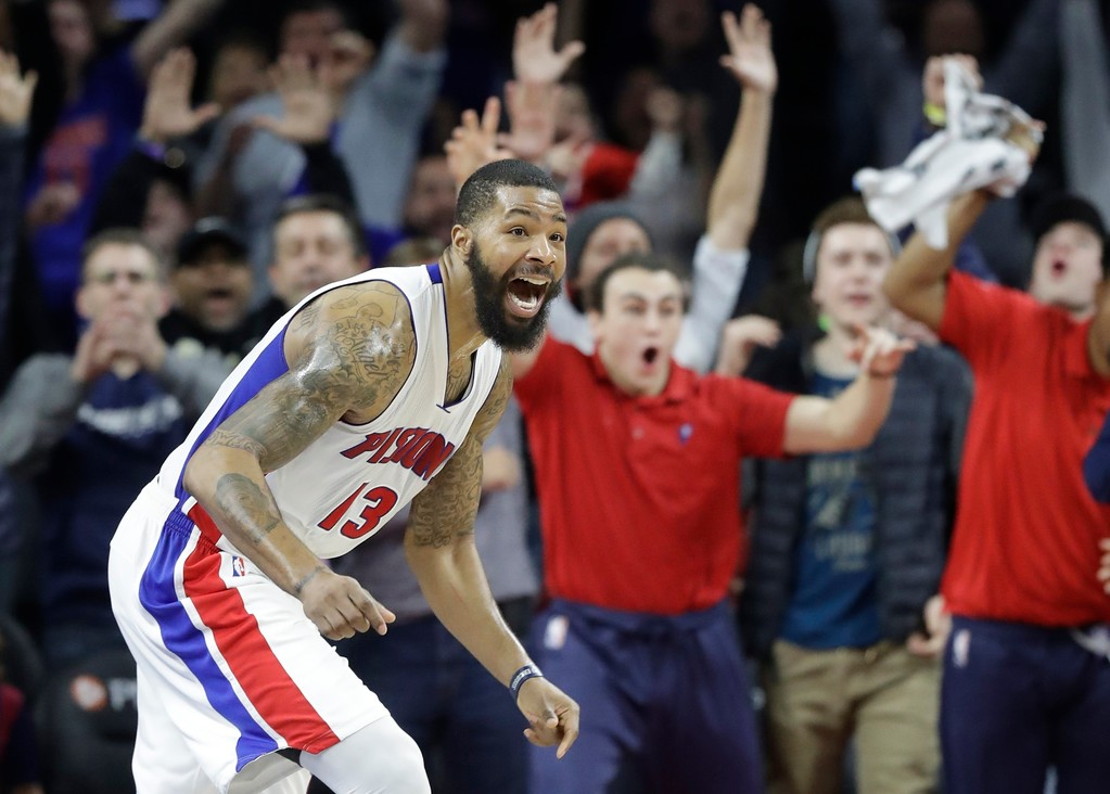. Detroit Pistons forward Marcus Morris and fans react after Morris\' game winning tip in during the second half of an NBA basketball game against the Washington Wizards, Saturday, Jan. 21, 2017, in Auburn Hills, Mich. Detroit defeated Washington 113-112. (AP Photo/Carlos Osorio)