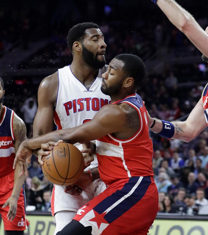 . Washington Wizards guard John Wall (2) reaches in and steals the ball away from Detroit Pistons center Andre Drummond during the first half of an NBA basketball game, Saturday, Jan. 21, 2017, in Auburn Hills, Mich. (AP Photo/Carlos Osorio)