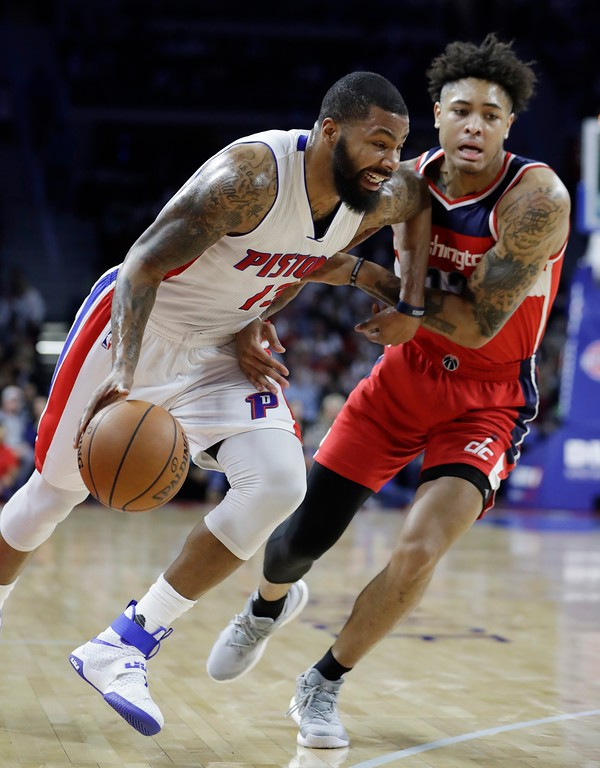 . Detroit Pistons forward Marcus Morris (13) drives on Washington Wizards forward Kelly Oubre Jr. during the first half of an NBA basketball game, Saturday, Jan. 21, 2017, in Auburn Hills, Mich. (AP Photo/Carlos Osorio)