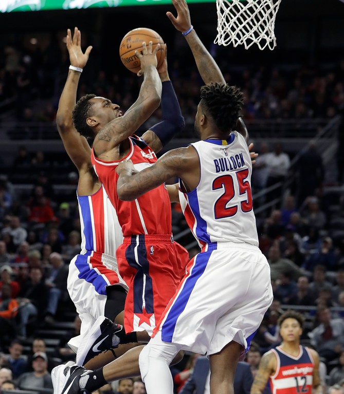 . Washington Wizards guard Sheldon McClellan shoots over the defense of Detroit Pistons forward Reggie Bullock (25) during the second half of an NBA basketball game, Saturday, Jan. 21, 2017, in Auburn Hills, Mich. (AP Photo/Carlos Osorio)