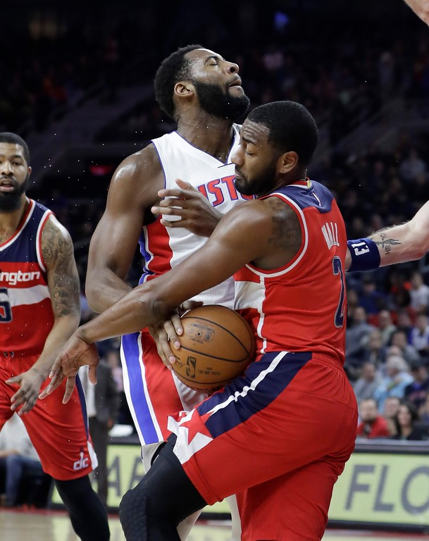 . Washington Wizards guard John Wall (2) steals the ball away from Detroit Pistons center Andre Drummond during the first half of an NBA basketball game, Saturday, Jan. 21, 2017, in Auburn Hills, Mich. (AP Photo/Carlos Osorio)